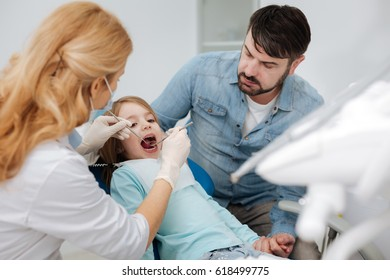 Loving dad taking her daughter to a doctor
