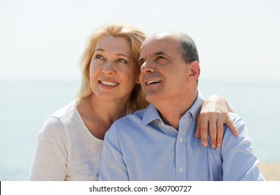 loving eldelry couple at sea on holiday smiling