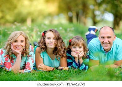 Loving family. Happy young family spending time together having fun in summer park, people concept. Family еnjoying time together