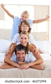 Loving family having fun in the bedroom