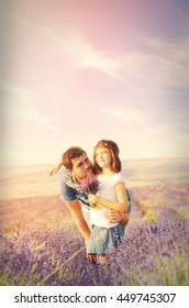 A loving father and cute little girl in a lavender field