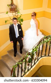 loving groom and the bride in stairs