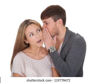Loving guy whispered something naughty in wife's ear.