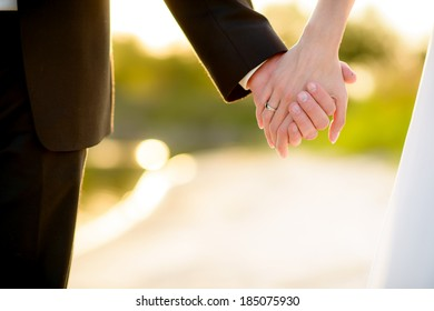 loving hands clasped of nature background