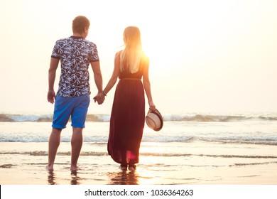 loving happy couple walking along the beach. Romantic vacation happy honeymoon