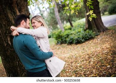 Loving happy couple walking in park