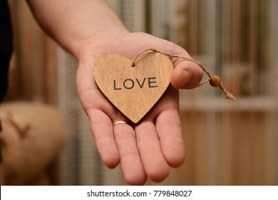 Loving heart in hand. Soft background blur