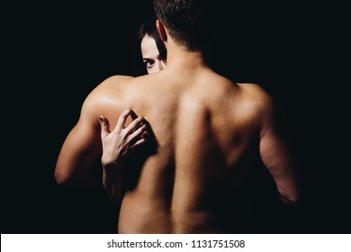Loving his body. Woman hand touch man torso, rear view. Couple in love. He is absolutely mine. Back disease and treatment. Massage for back health. Sex games.
