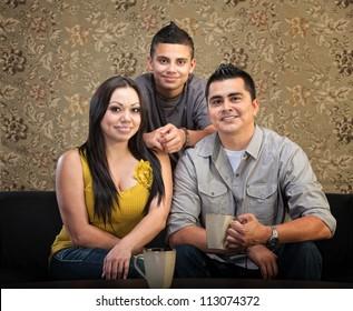 Loving Latino family of three sitting together