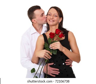 a loving man holding a red roses for his woman