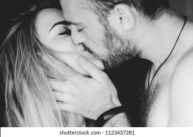 Loving man and woman, happy young sensual couple,blurred background