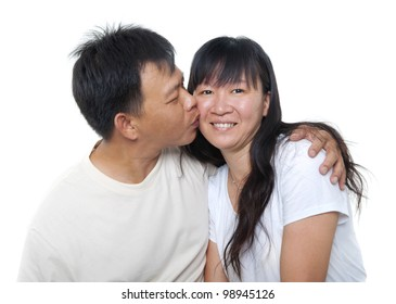 Loving Mature Asian couple kissing on white background