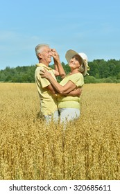 Loving mature couple dancing  in field  at summer