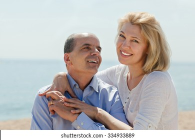 Loving mature couple at sea vacation