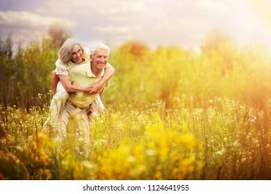 Loving mature couple  in summer park
