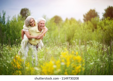 Loving mature couple  in summer park