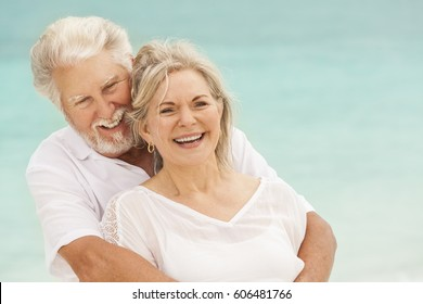 Loving mature male female Caucasian couple living a healthy outdoor leisure lifestyle on a Caribbean beach