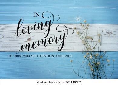 In loving memory sign calligraphy on vintage white background.