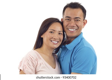 Loving  middle aged Asian Couple isolated over white background