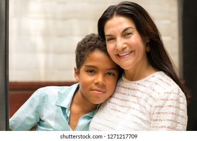 Loving mom smiling and hugging her son.