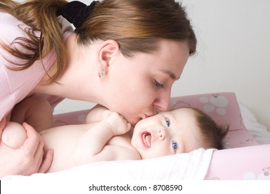 Loving mother cradling newborn baby in her arms