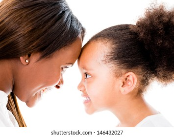 Loving mother and daughter with heads together - isolated over white
