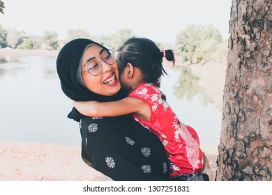 Loving mother hugging cute little daughter showing love care support, happy woman embracing girl at home, sincere warm happy relationships, Appreciating Moms concept