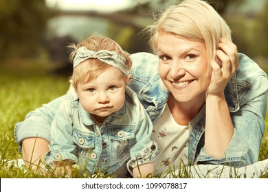 Loving mother portraiting in sunny afternoon with her daughter