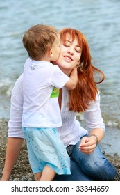 loving mother and son on natural background