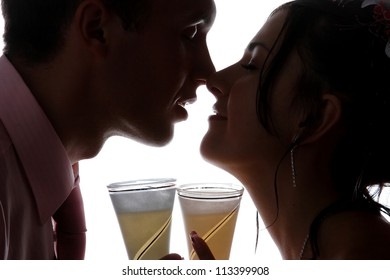 loving newlyweds with glasses of champagne