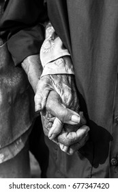 Loving old couple holding hands