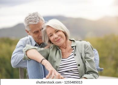 Loving portrait of modern senior couple outdoors