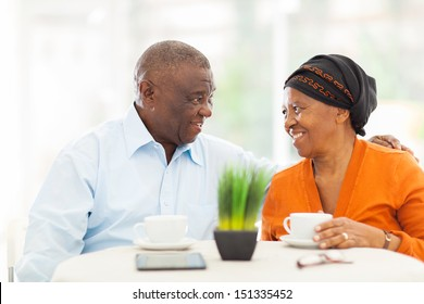 loving senior african couple relaxing at home