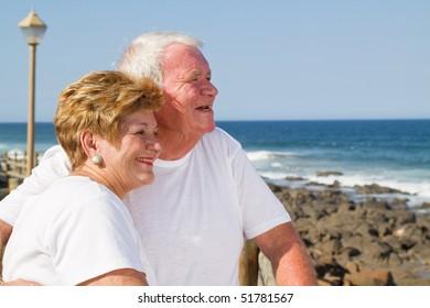 loving senior citizen couple on beach