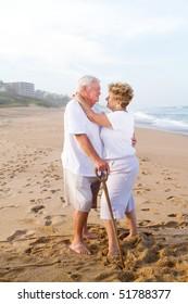 loving senior couple hugging on beach