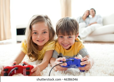 Loving siblings playing video game in the living room