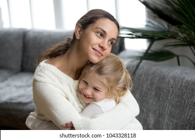 Loving single mother hugging cute little daughter showing love care support, happy woman embracing preschool girl at home, mum and kid sincere warm relationships, new mom for adopted child concept