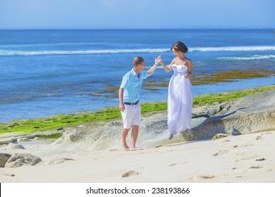 Loving Wedding Couple on Ocean Coastline.Bali.Indonesia.