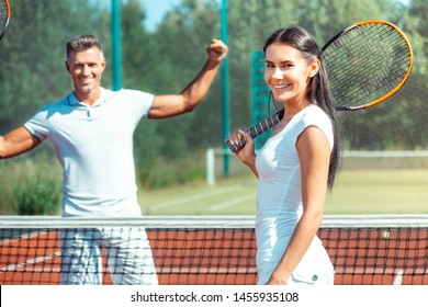 Loving wife smiling. Loving wife smiling after playing tennis at the weekend with handsome husband