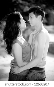 loving young asian couple hugging each other in the garden
