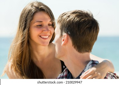 Loving young girl and her boyfriend smiling