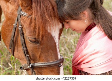 Loving young girl with her horse