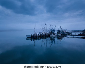 Low aerial view of shrimp boats in port in Port Royal, South Carolina.