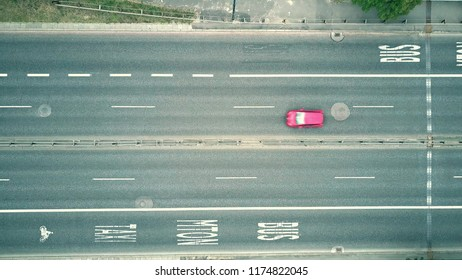 Low altitude aerial top down view of city highway with bus lanes