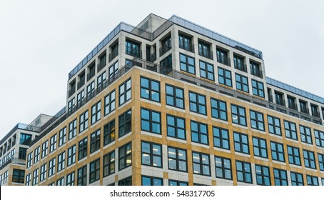Low Angle Architectural Exterior View of Modern Low Rise Mixed Use Residential and commercial Urban Building on Overcast Day