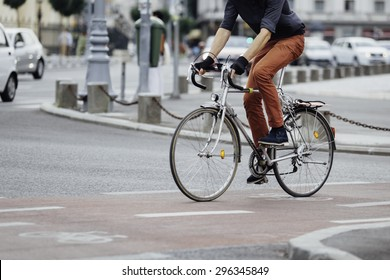 low angle of a casual man on bike