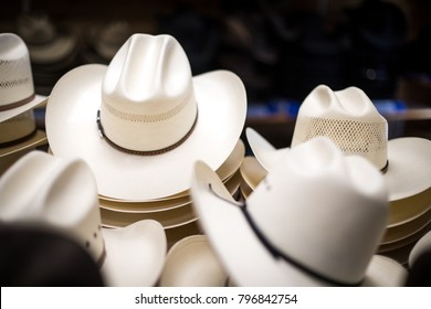 Low angle close up on a stack of traditional western cowboy hats 678273eb4d4