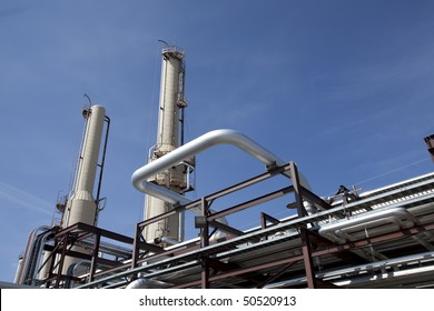 Low angle, exterior view of the piping at a gas compressor plant. Horizontal shot.