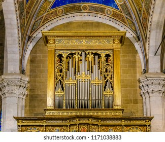 Low angle front view old pipe organ inside italian church