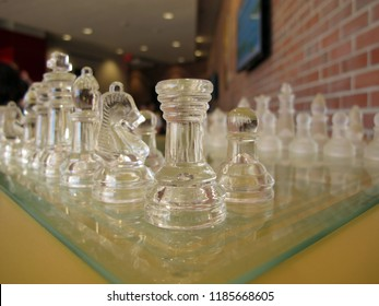 Low angle of glass chess pieces. Color image.